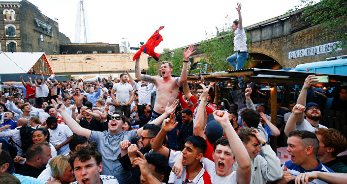 England soccer fans watch the team's first match in the World Cup against Tunisia at Flat Iron Square in London, Britain, June 18, 2018
