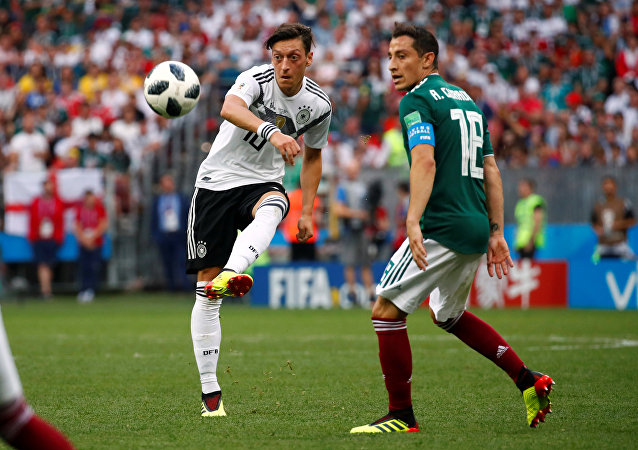 Soccer Football - World Cup - Group F - Germany vs Mexico - Luzhniki Stadium, Moscow, Russia - June 17, 2018 Germany's Mesut Ozil in action with Mexico's Andres Guardado