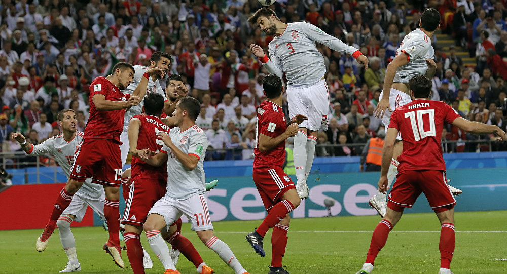 Spain's Gerard Pique, center, jumps for a header during the group B match between Iran and Spain at the 2018 soccer World Cup in the Kazan Arena in Kazan, Russia, Wednesday, June 20, 2018.