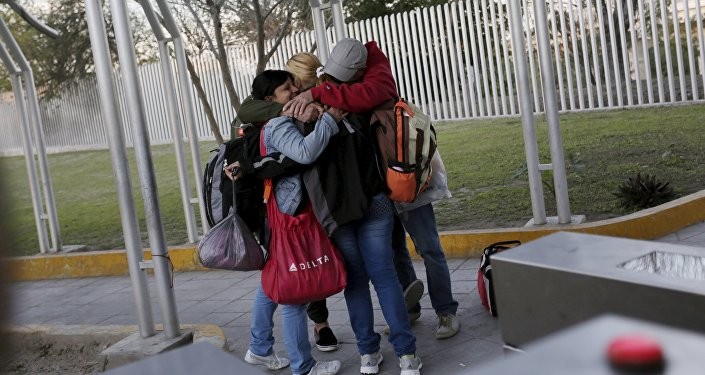 Cuban migrants embrace after traveling en route from Costa Rica to El Salvador, Guatemala and Mexico, before continuing their journey to U.S., on the border between the U.S. and Mexico in Reynosa, in Tamaulipas state, Mexico