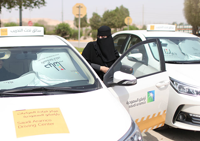 Trainee Amira Abdelgader gets into a car for her driving lesson at Saudi Aramco Driving Center in Dhahran, Saudi Arabia, June 6, 2018