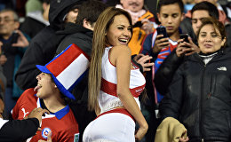 A supporter of Peru poses as she waits for the start of the 2015 Copa America football championship quarter-final match between Peru and Bolivia, in Temuco, Chile, on June 25, 2015