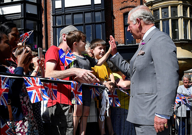Britain's Prince Charles 'high-fives' a well-wisher during visit to Salisbury in southwest Britain, June 22, 2018