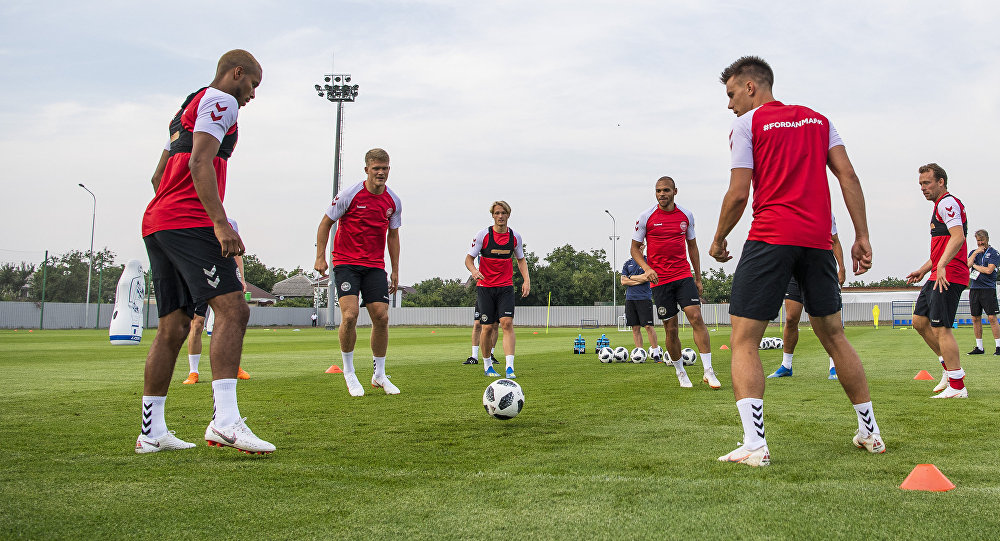 Denmark's players make passes with a ball during a training session in Vityazevo on June 22, 2018, during the Russia 2018 World Cup football tournament
