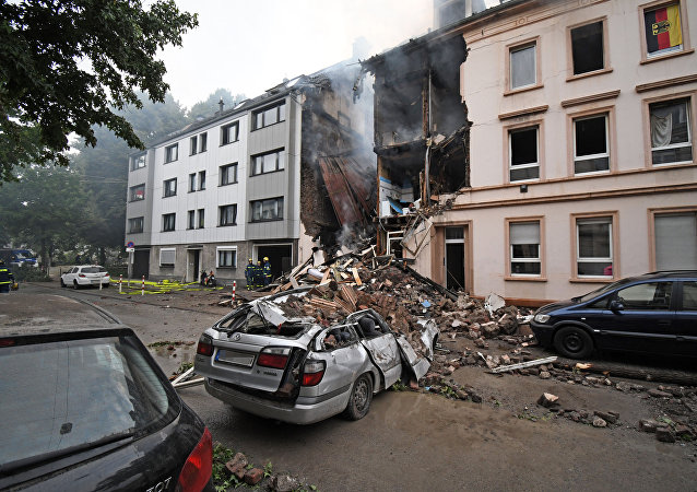 A car is covered by debris of a house that has exploded in the night in Wuppertal, western Germany, on June 24, 2018