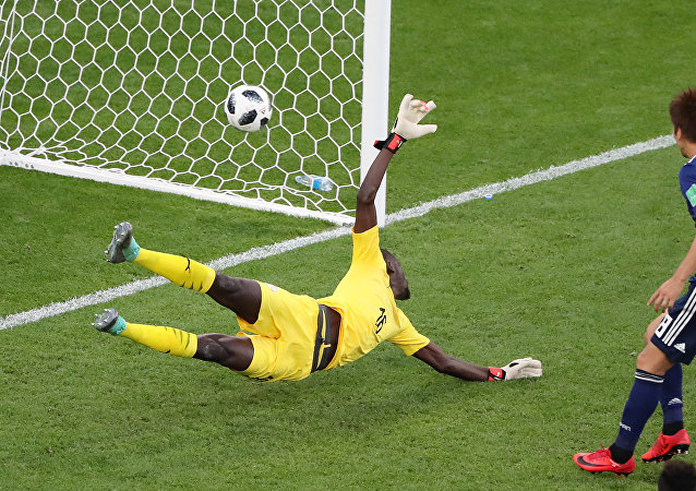 Soccer Football - World Cup - Group H - Japan vs Senegal - Ekaterinburg Arena, Yekaterinburg, Russia - June 24, 2018 Senegal's Khadim N'Diaye is beaten as Japan's Takashi Inui (not pictured) scores their first goal