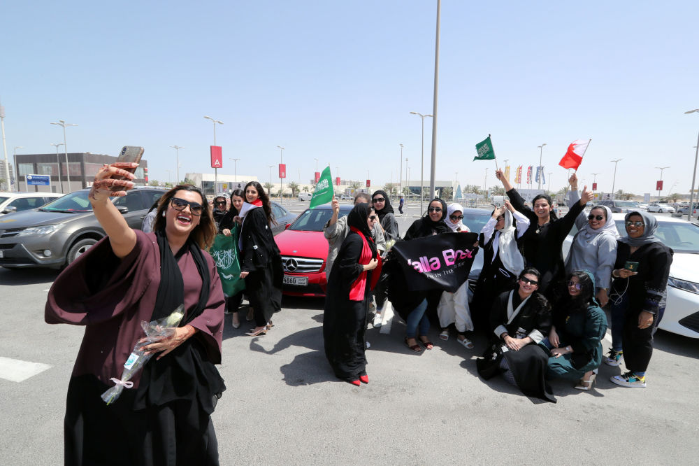 Saudi and Bahraini women celebrate the lifting of the driving ban