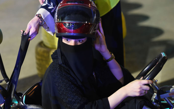 Saudi woman prepares to use go-kart in Riyadh