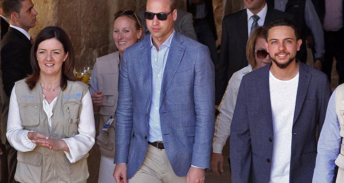 Britain's Prince William (C) and Jordanian Crown Prince Hussein bin Abdullah (R) visit the Jerash archaeological site, some 50 kilometres north of the Jordanian capital Amman, on June 25, 2018.