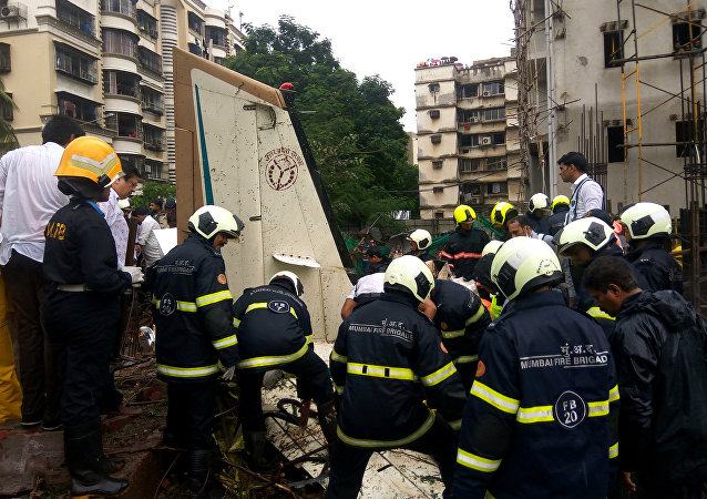 Firefighters inspect the sight of a plane crash in Mumbai, India June 28, 2018