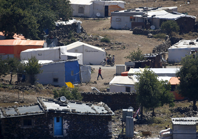 A picture taken on June 26, 2018 from the Israeli-annexed Syrian Golan Heights shows a camp for displaced Syrians near the Syrian village of Breqa