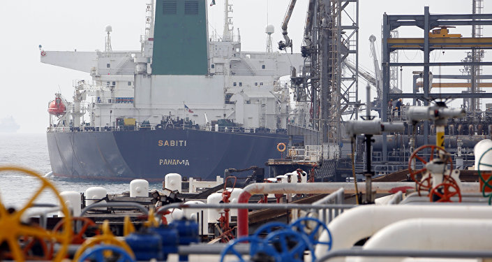 This file photo taken on March 12, 2017 shows an Panamanian tanker docking at the platform of the oil facility in the Khark Island, on the shore of the Gulf