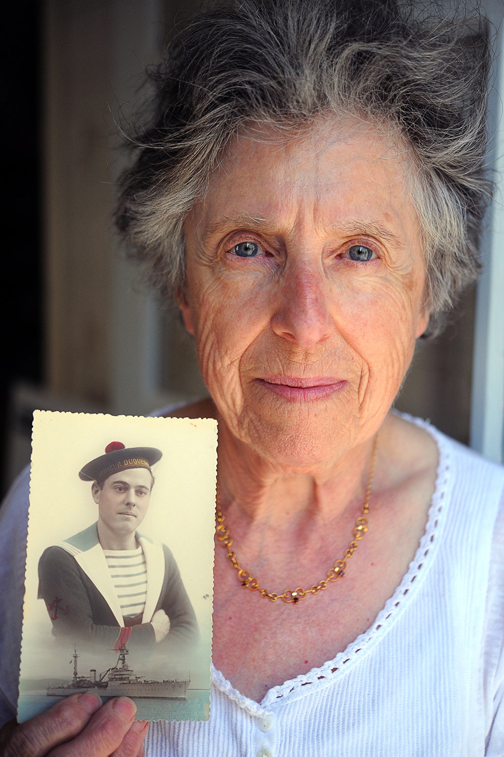 Denise Ollivier, from Paimpol in western France, holds a photograph of her father who died at Mers-el-Kebir