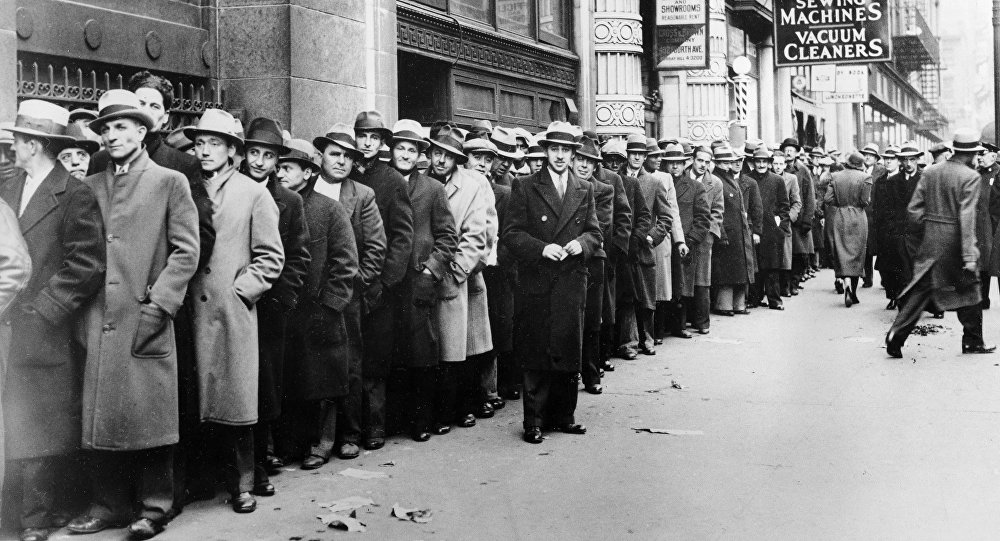 Unemployed people, numbering about 5,000, wait outside the State Labor Bureau which houses the State Temporary Employment Relief administration in New York City, are shown in this Nov. 24, 1933 file photo