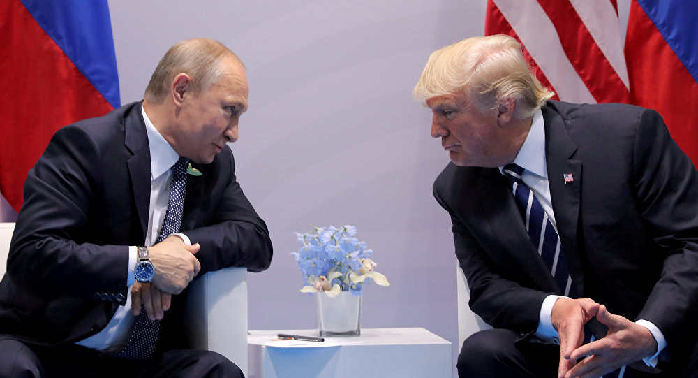 Russia's President Vladimir Putin talks to U.S. President Donald Trump during their bilateral meeting at the G20 summit in Hamburg, Germany, July 7, 2017