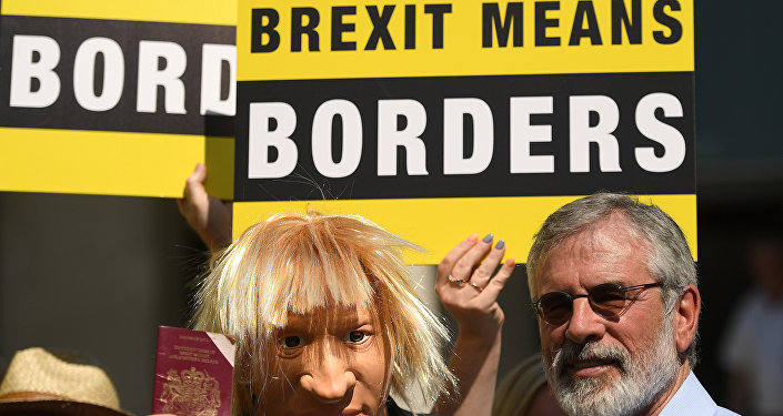 An actor wearing a Boris Johnson mask is joined by Sinn Fein's Gerry Adams during a 'Borders Against Brexit' protest in the border town of Dundalk, Ireland, June 28, 2018