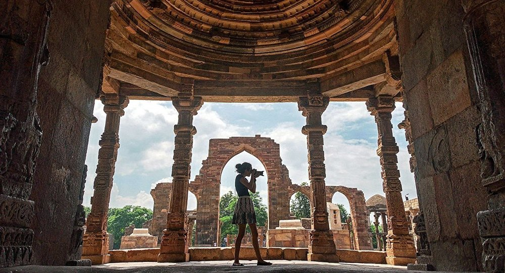 A young lady capturing the several historically significant monuments and architecture details inside Qutab Minar