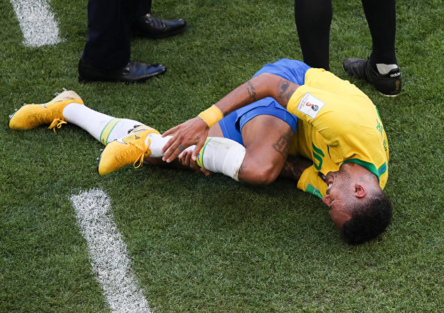 Brazil's Neymar lies on the ground suffering after a collision during the World Cup Round of 16 soccer match between Brazil and Mexico at the Samara Arena, in Samara, Russia, July 2, 2018