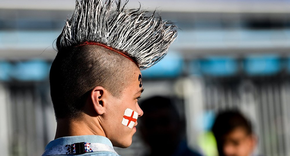 A fan waits for the start of the World Cup Group G soccer match between Tunisia and England in Volgograd, Russia, June 18, 2018.