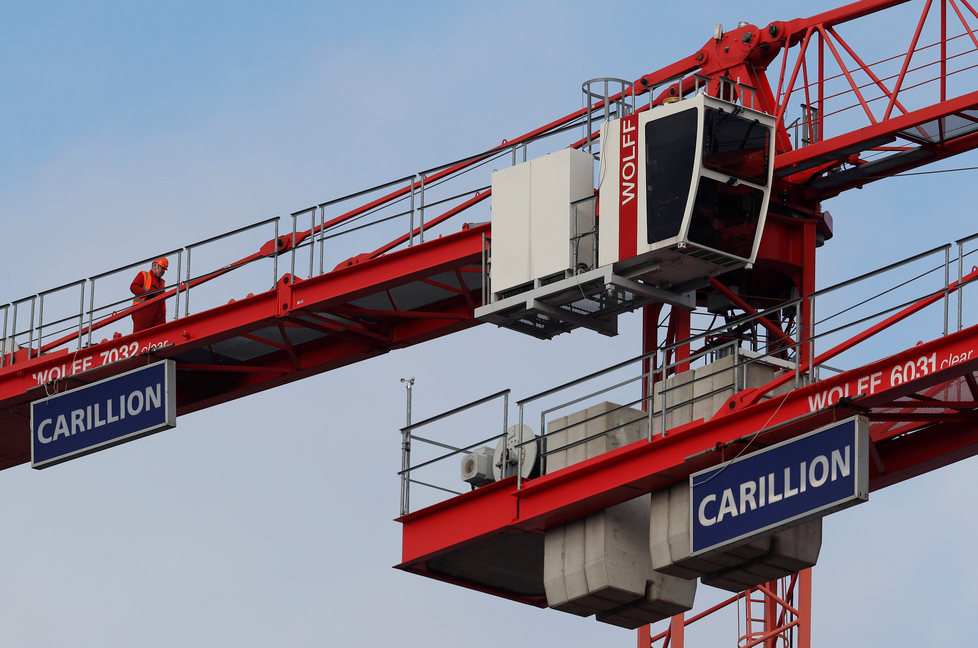 A worker walks along a crane on Carillion's Midland Metropolitan Hospital construction site in Smethwick, Britain January 29, 2018