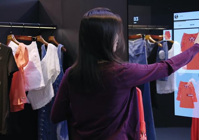 Woman Selects Clothing on Smart Mirror at Alibaba's FashionAI Store in Hong Kong