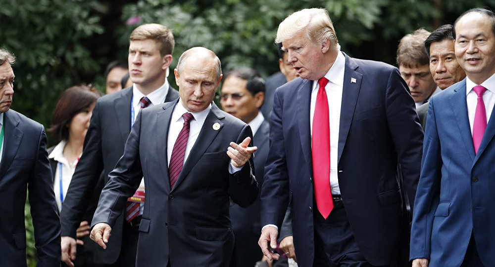 U.S. President Donald Trump, center right, and Russia's President Vladimir Putin, center left, talk during the family photo session at the APEC Summit in Danang, Saturday, Nov. 11, 2017