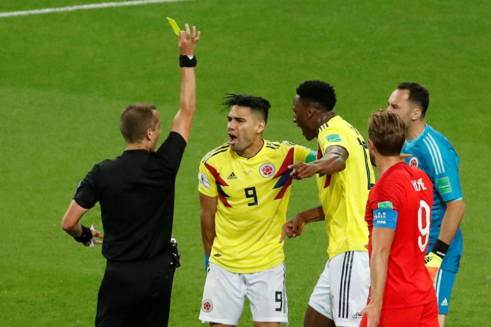 Soccer Football - World Cup - Round of 16 - Colombia vs England - Spartak Stadium, Moscow, Russia - July 3, 2018 Colombia's Radamel Falcao is shown a yellow card by referee Mark Geiger