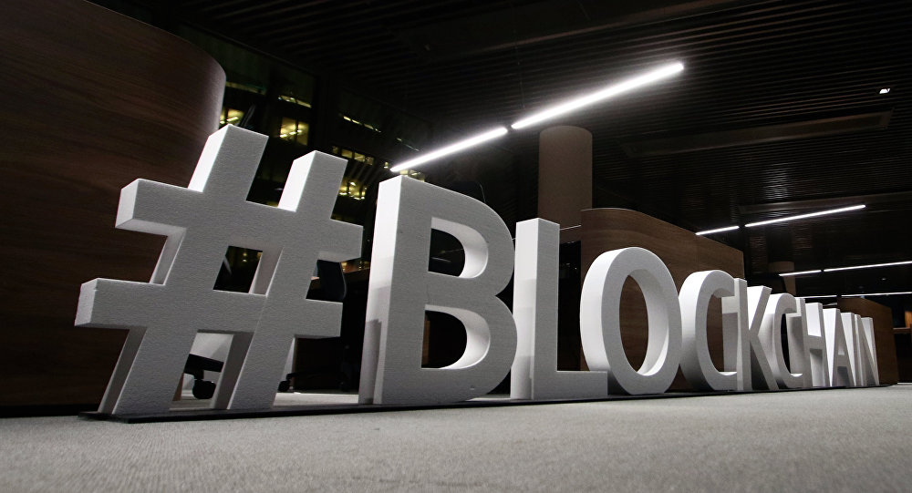 Giant letters, reading the word blockchain are displayed at the blockchain centre, which aims at boosting start-ups, on February 7, 2018 in Lithuania's capital Vilnius
