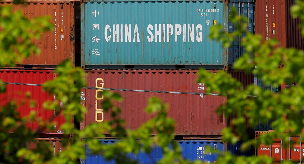 Shipping containers, including one labelled China Shipping, are stacked at the Paul W. Conley Container Terminal in Boston, Massachusetts, U.S., May 9, 2018