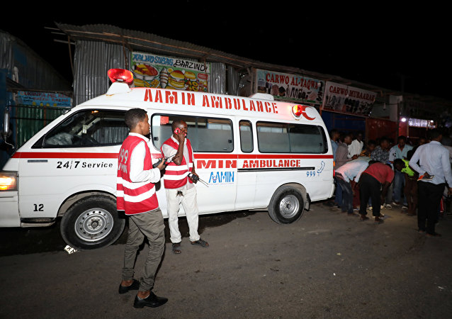(File) Paramedics stand near an Aamin Ambulance emergency service near the scene of an explosion at the Benadir junction in Mogadishu, Somalia July 2, 2018