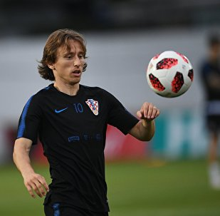 Croatia's Luka Modric plays with a ball during a national soccer team's training session ahead of the World Cup quarter-final soccer match between Russia and Croatia, at a training base in Sochi, Russia, July 4, 2018