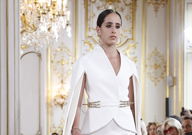A model presents a creation by Antonio Grimaldi during the 2018-2019 Fall/Winter Haute Couture collection fashion show in Paris, on July 2, 2018