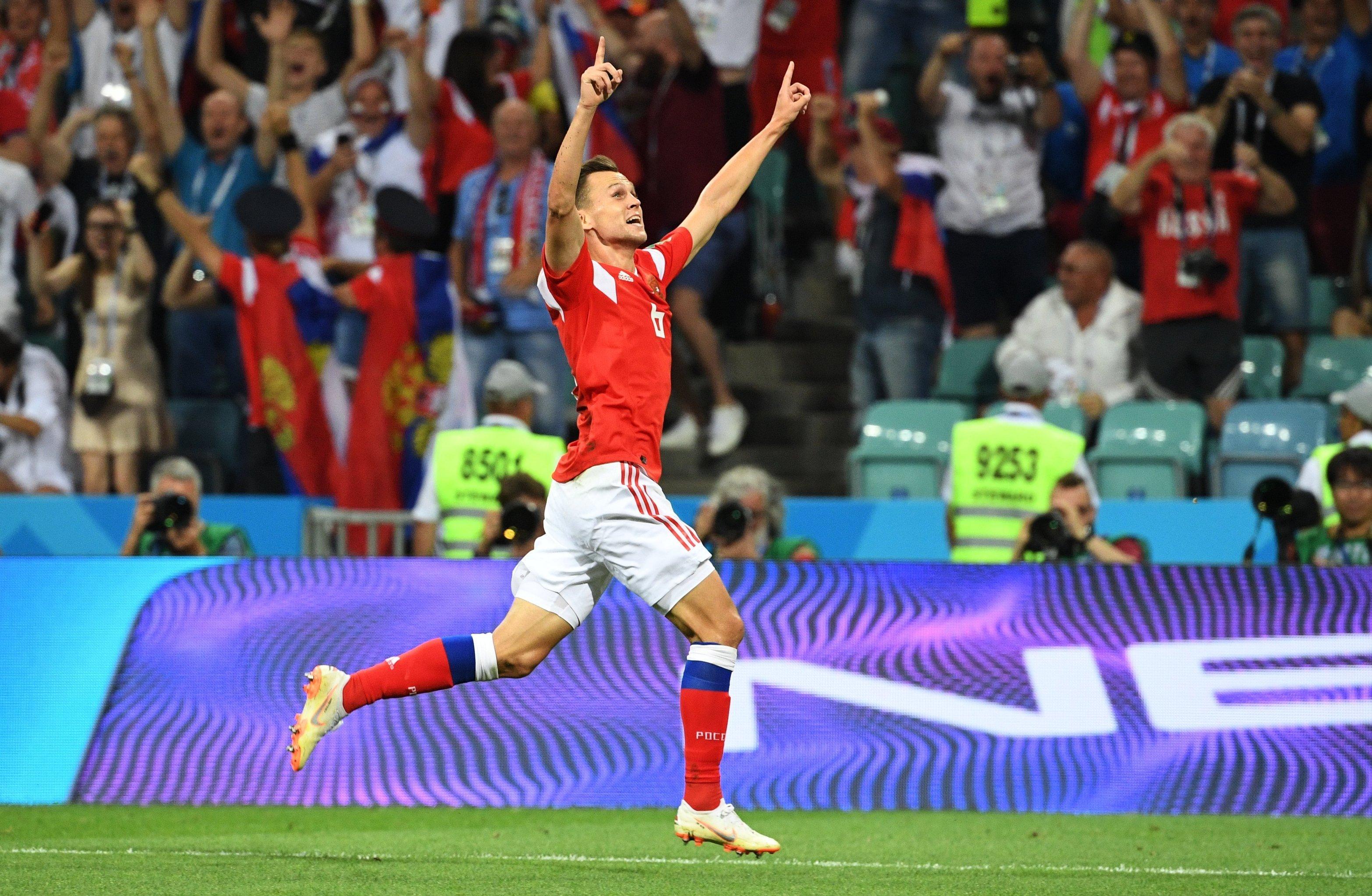 Russia's midfielder Denis Cheryshev triumphs after he scored a goal in the match against Croatia.