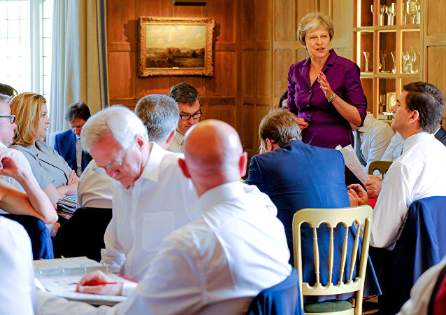 Britain's Prime Minister Theresa May commences a meeting with her cabinet to discuss the government's Brexit plans at Chequers, the Prime Minister's official country residence, near Aylesbury, Britain, July 6, 2018