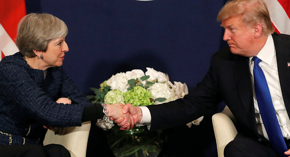 U.S. President Donald Trump shake hands with Britain's Prime Minister Theresa May during the World Economic Forum (WEF) annual meeting in Davos, Switzerland January 25, 2018