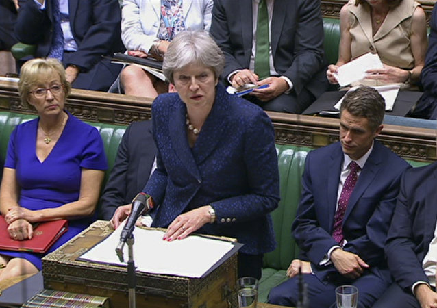 In this image from TV, Britain's Prime Minister Theresa May gives a statement to parliament Monday July 9, 2018.