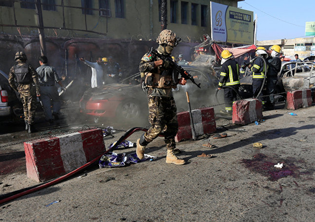 Afghan security forces inspect the site of a blast in Jalalabad city, Afghanistan, July 1, 2018