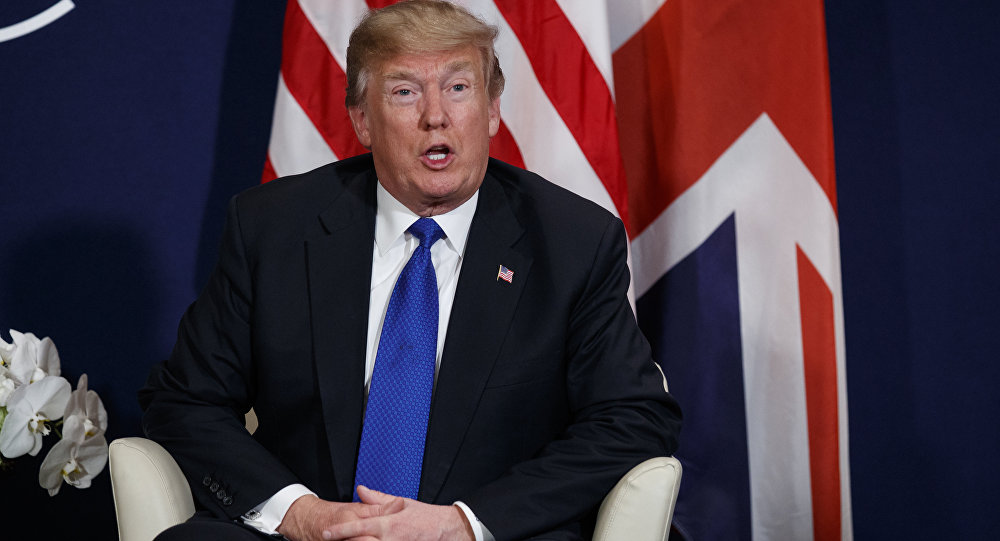 President Donald Trump listens during a meeting with British Prime Minister Theresa May at the World Economic Forum, Thursday, Jan. 25, 2018, in Davos.