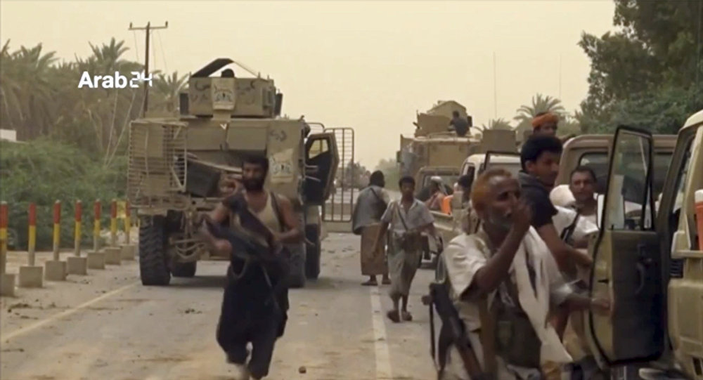 This Saturday, June 16, 2018 file still image taken from video provided by Arab 24 shows Saudi-led forces gathering to retake the international airport of Yemen's rebel-held port city of Hodeida from the Shiite Houthi rebels.
