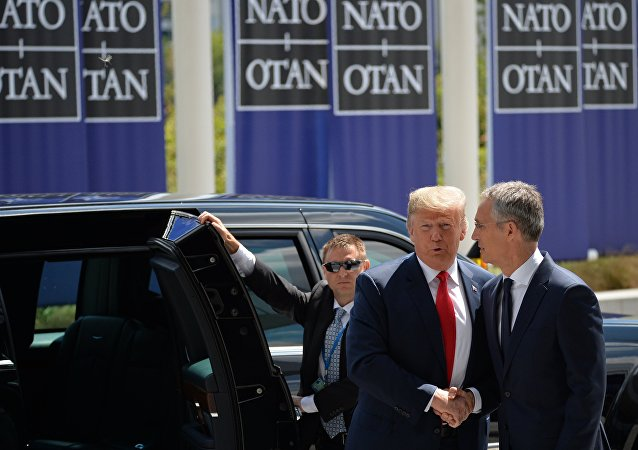 US President Donald Trump (L) and NATO Secretary General Jens Stoltenberg (R) are shaking hands at the meeting of NATO Heads of State and Government in Brussels, Belgium on 11 July 2018
