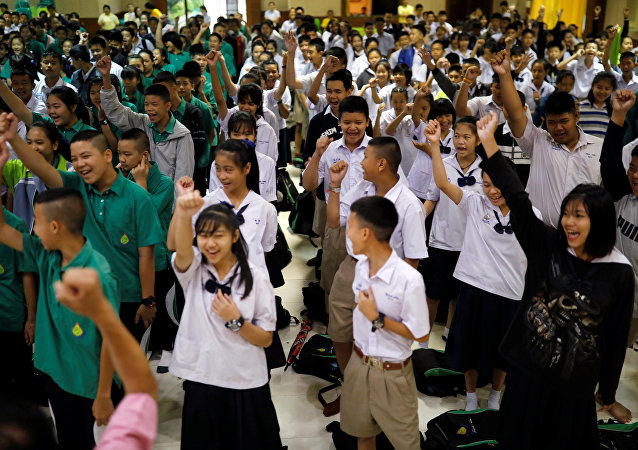 Students at Mae Sai Prasitsart School, which some of the boys attend, celebrate their rescue