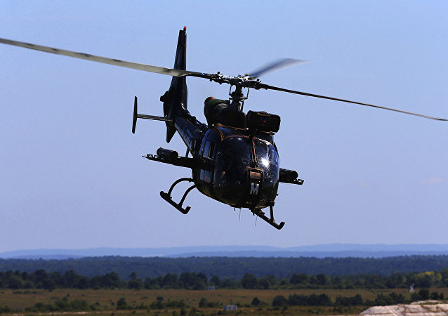 A French army Gazelle helicopter participates on June 26, 2018, during military manoeuvres at the Combined Armed Forces Shooting Training Center (CETIA-S) in Suippes, eastern France.