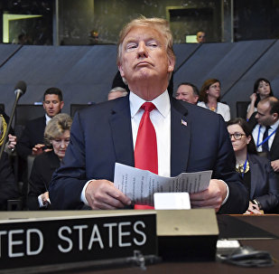 U.S. President Donald Trump attends a meeting of the North Atlantic Council during a summit of heads of state and government at NATO headquarters in Brussels on Wednesday, July 11, 2018.