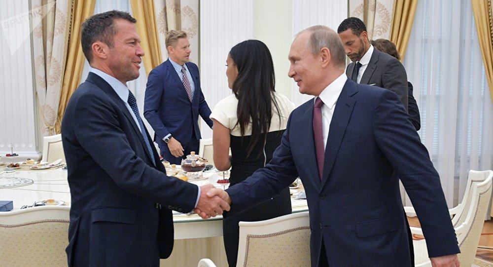 July 6, 2018. Russian President Vladimir Putin during a meeting with world football legends. Left - German footballer Lothar Matthaus