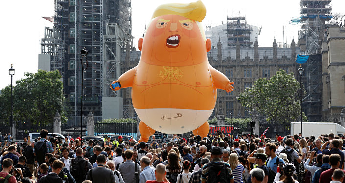 Demonstrators fly a blimp portraying U.S. President Donald Trump, in Parliament Square, during the visit by Trump and First Lady Melania Trump in London, Britain July 13, 2018