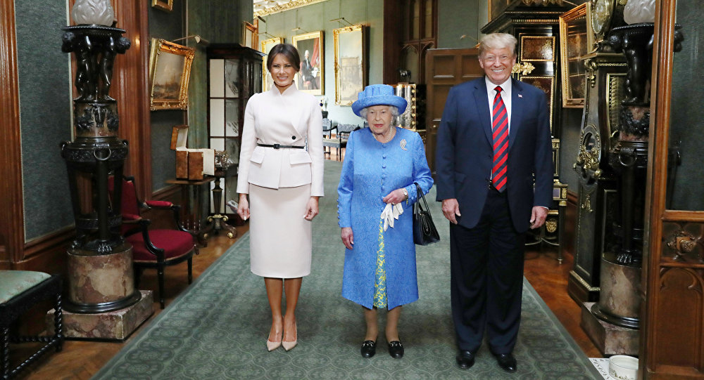 Britain's Queen Elizabeth stands with U.S. President Donald Trump and his wife, Melania in the Grand Corridor during their visit to Windsor Castle, Windsor, Britain July 13, 2018