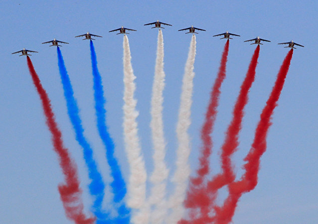 Alpha jets from the French Air Force Patrouille de France fly during the traditional Bastille Day military parade on the Champs-Elysees Avenue in Paris, France, July 14, 2018