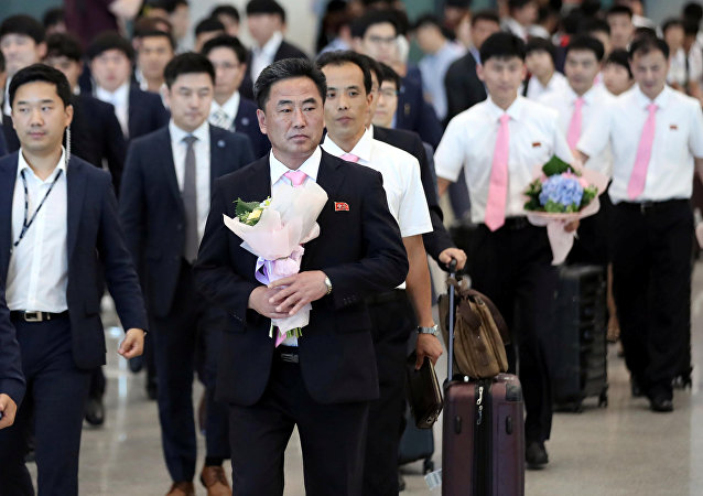 North Korean table tennis team members arrive at the Incheon International Airport to take part in the Seamaster 2018 ITTF World Tour Platinum Korean Open in Daejeon, South Korea, July 15, 2018