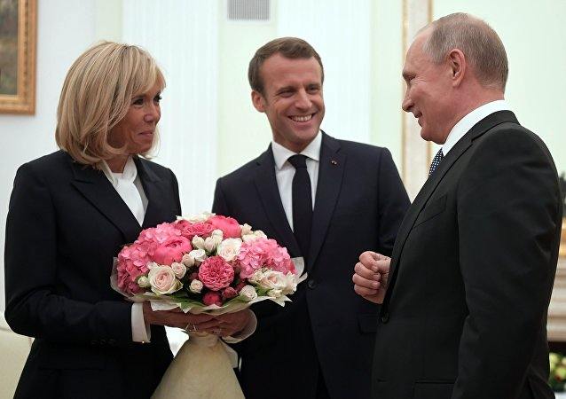 Russian Presiden Vladimir Putin Meets French President Emmanuel Macron and Wife