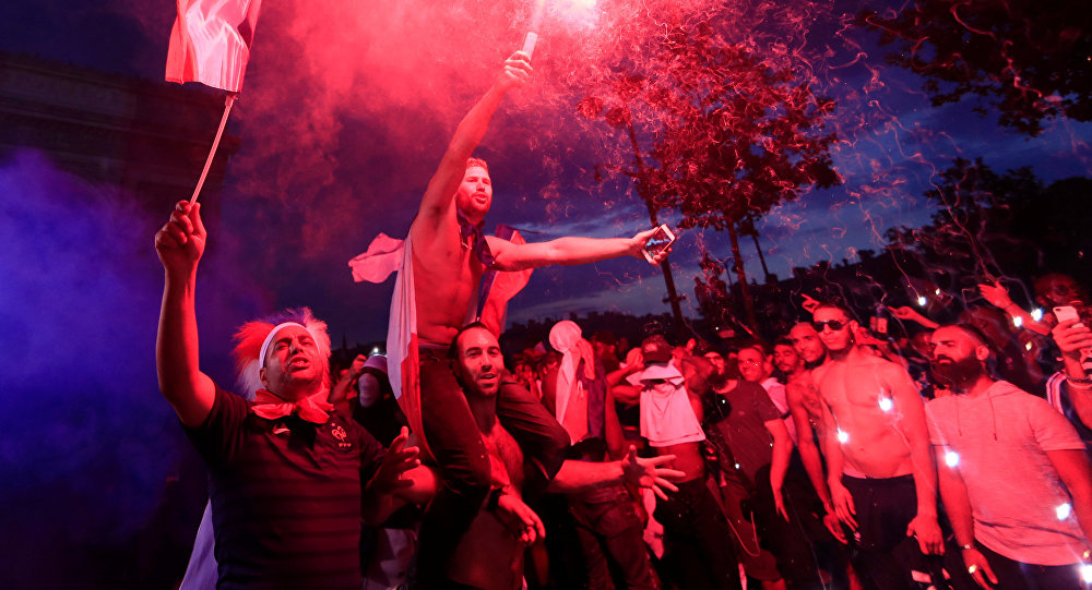 Soccer Football - World Cup - Final - France vs Croatia - Paris, France, July 15, 2018 - France fans celebrate on the Champs-Elysees Avenue after France win the Soccer World Cup final.